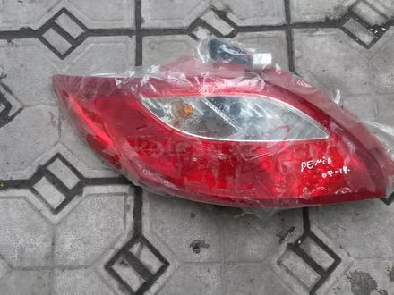 На Mazda Demio — Mazda 2 фонарь Мазда Демио —… за 15 000 тг. в Алматы