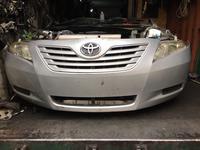 Бампер передний на Toyota Camry оригинальный б. У америка за 100 000 тг. в Алматы