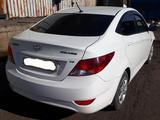 Hyundai Solaris 2012 года за 2 800 000 тг. в Караганда – фото 4