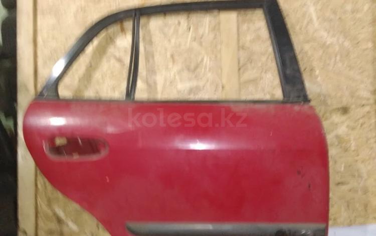 Дверь задняя правая мазда 626 1998г. (птичка, хетчбег) за 5 000 тг. в Караганда