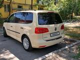 Volkswagen Touran 2011 года за 4 900 000 тг. в Алматы – фото 5