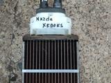 Радиатор печки Мазда кседокс 9 за 15 000 тг. в Караганда
