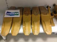 Коронки зубья адаптеры бокорезы на экскаватор в Караганда