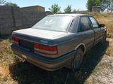 Mazda 626 1990 года за 600 000 тг. в Шымкент – фото 4